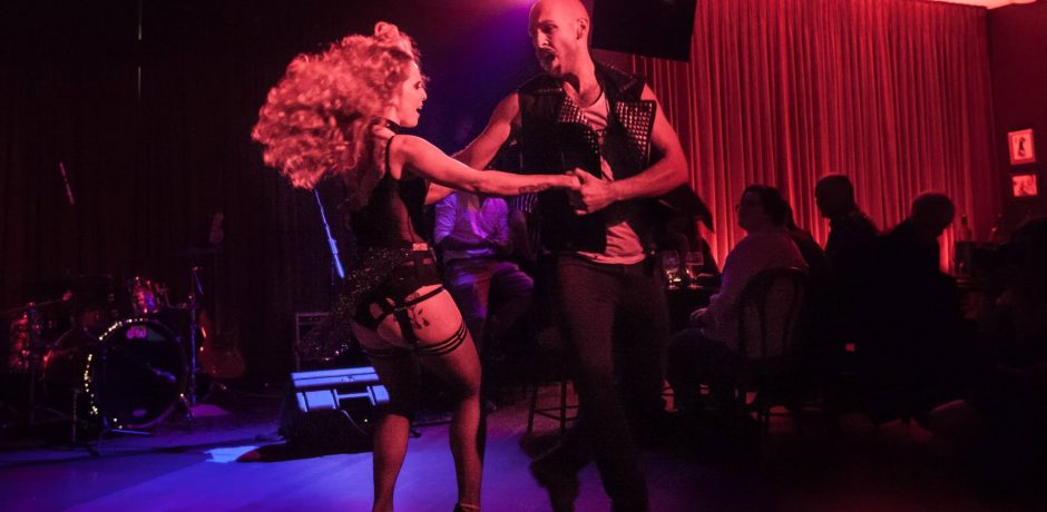 Live shot of Burlesque Dancers Kelly Ann Doll & The Tasteless Gentleman in action at Wanted & Wild Show at The Birdcage Sydney
