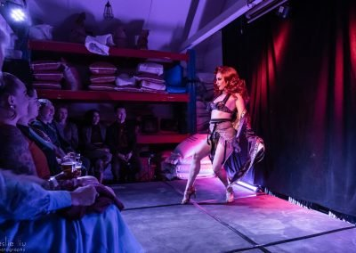 A shot of Kelly Ann Doll live on stage for Falcons Burlesque in Glebe