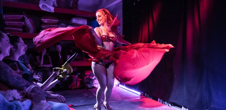 A live shot of Burlesque Dancer Kelly Ann Doll on stage at Slide on Oxford Street accompanyed by Michael Wheatley on Piano